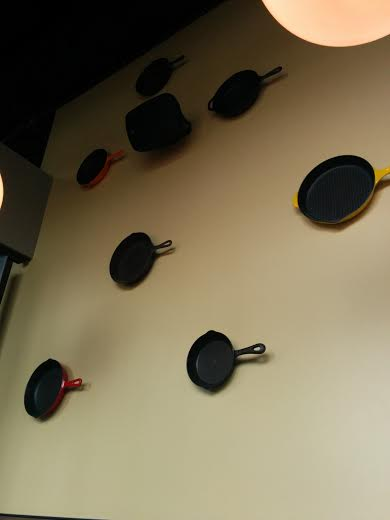 The nod to its namesake, a wall of skillets